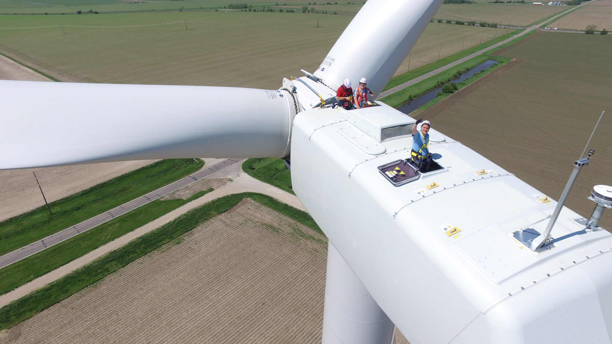 Aerial shot of a Bluestem crew on top of a wind turbine.
