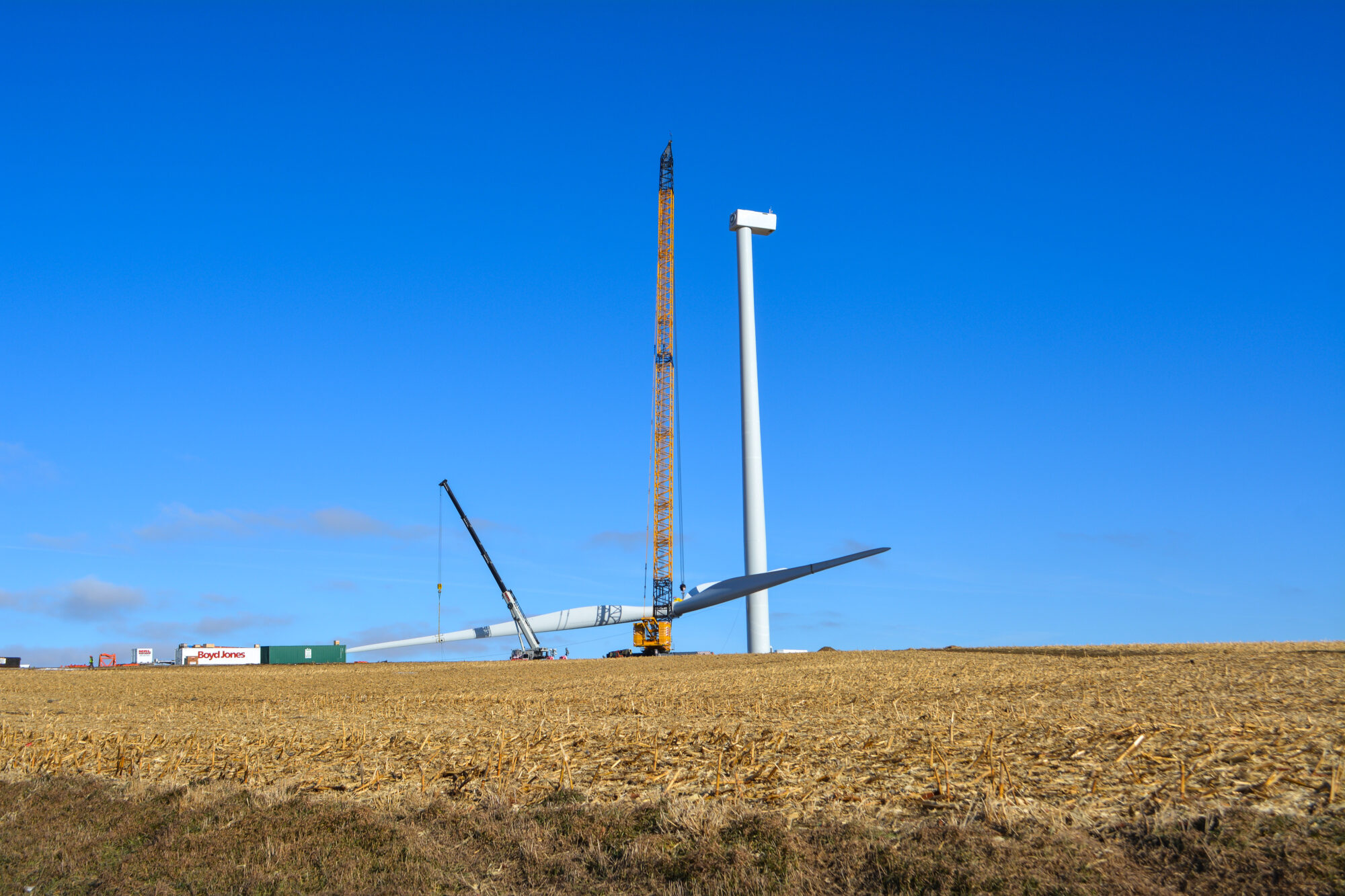 Shot of a wind turbine being assembled on site.