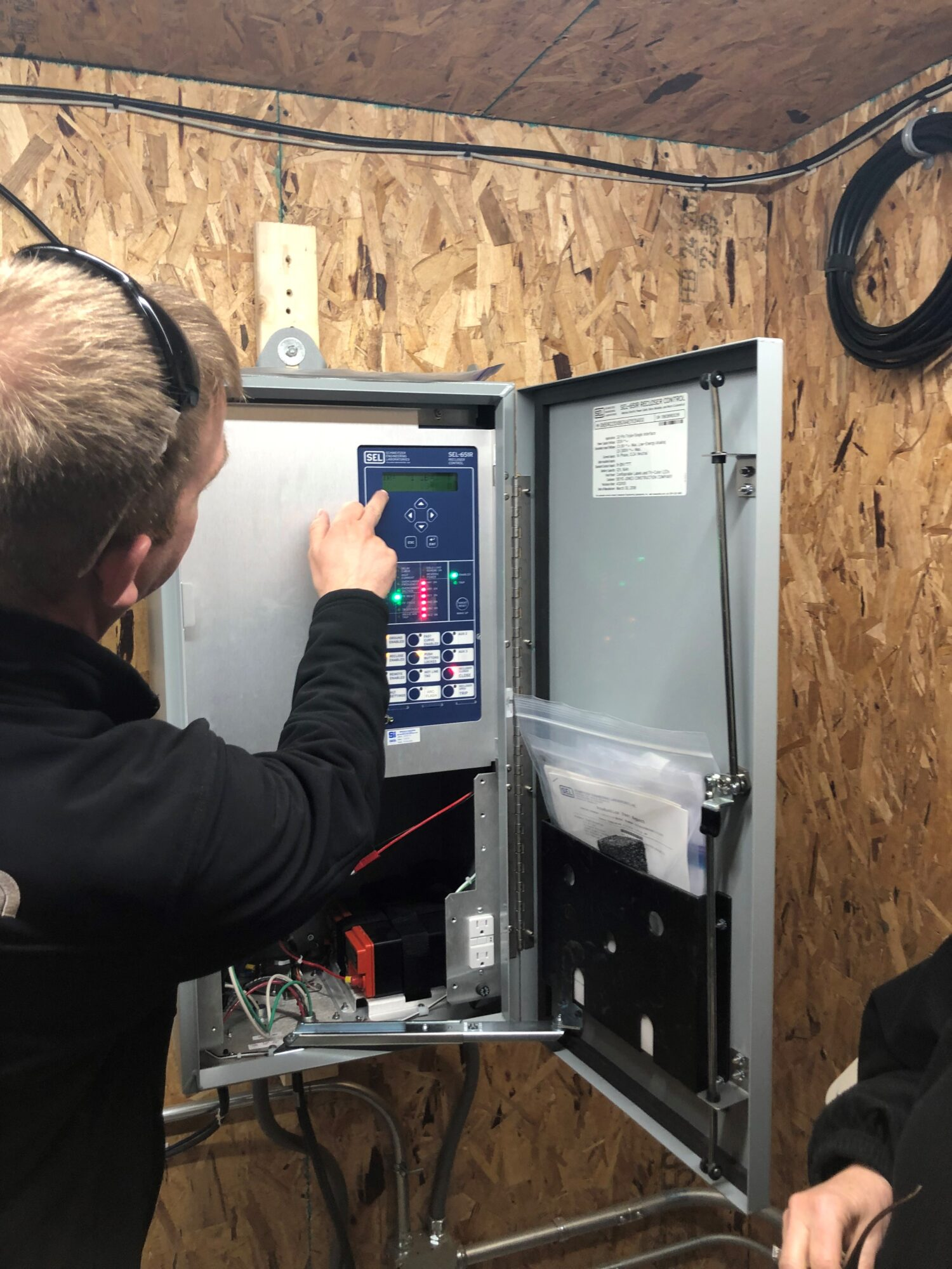 Energy Technician working in a connection box.
